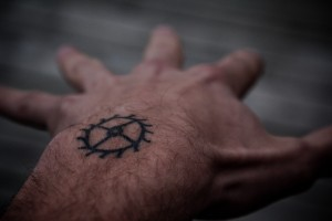 small tattoo on man's hand