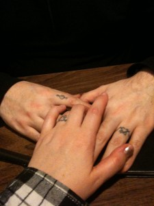 3 hands with 3 different finger tattoo ideas
