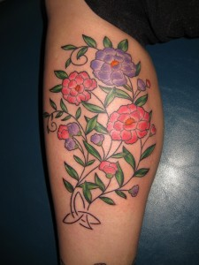 beautiful flower tattoo on calf