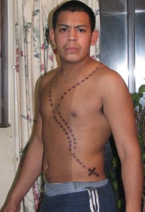 rosary tattoo on chest