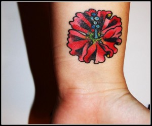 Red hibiscus tattoo