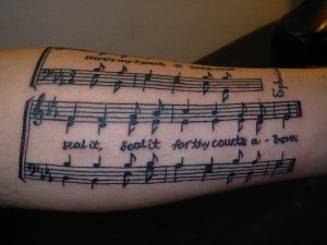 Sheet Music Forearm Tattoo