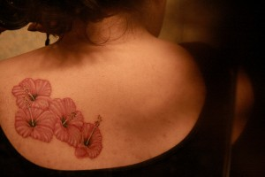 Multiple Hawaiian Flowers Tattoos