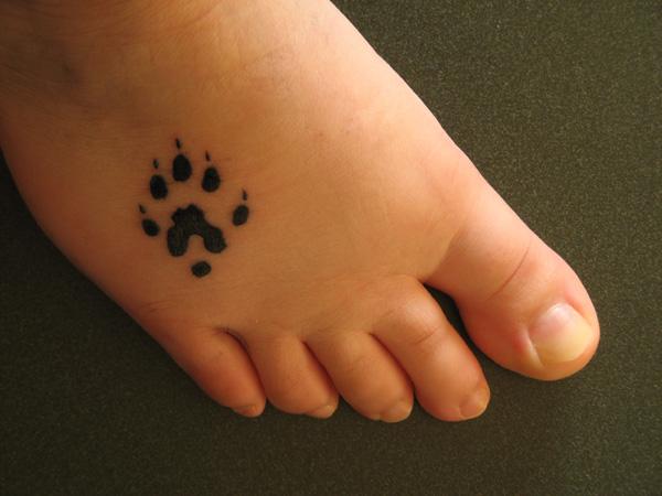 Paw Print Tattoo On Bottom Of Foot: 15 Playful Dog Paw Tattoos