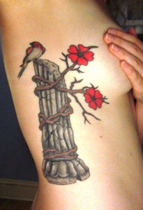 Flowers, Bamboo and A Bird ribcage tattoo