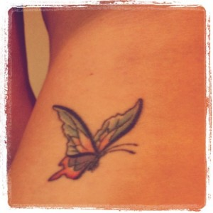 cute butterfly tattoo on the hip