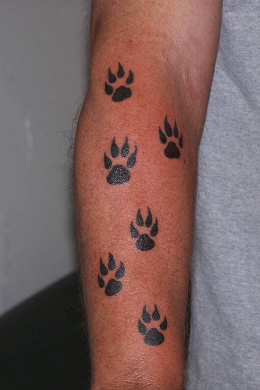 9f24c6ce8 15 Playful Dog Paw Tattoos - Tattoo Me Now