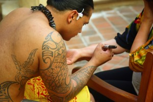 Tattoo artist with hawaiian style tattoo