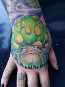 Green Monster Mushroom Tattoo