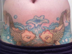 two identical koi Fish Tattoos on stomach
