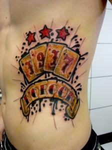 Four Aces Ribcage Tattoo