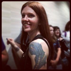 Girl w/ Dragon Tattoo on arm