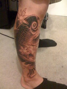 Black and white koi tattoo on calf