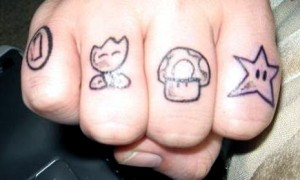 Nintendo Knuckle Tattoo