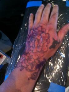 Peony flower tattoo on hand