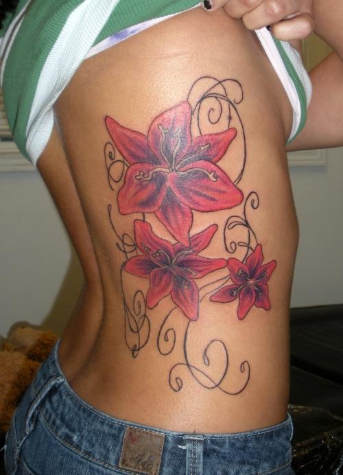Women On Rib Cage Tattoos