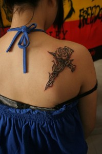 Symbol and Black Rose Tattoo