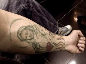 Jesus forearm tattoo