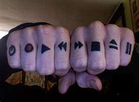 Technology Symbols Knuckle Tattoo