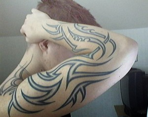Tribal Design Forearm Tattoo