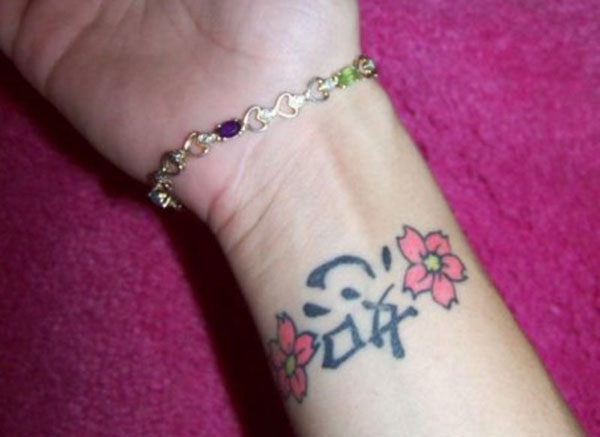 30 phenomenal wrist tattoos you don 39 t want to miss for Cherry blossom tattoo wrist
