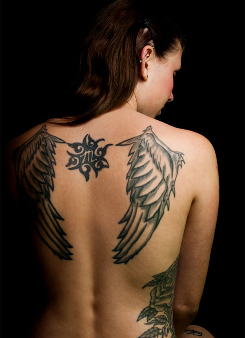 Wing and Zodiac Tattoo