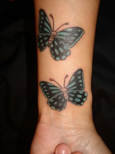 Two Butterflies wrist tattoos