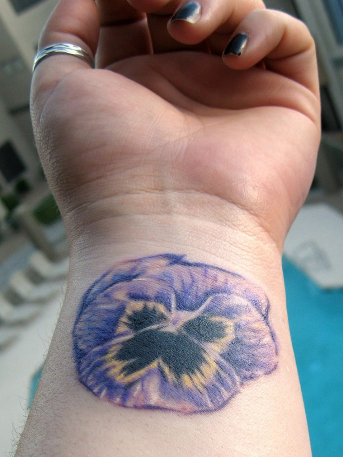 flower tattoo on wrist