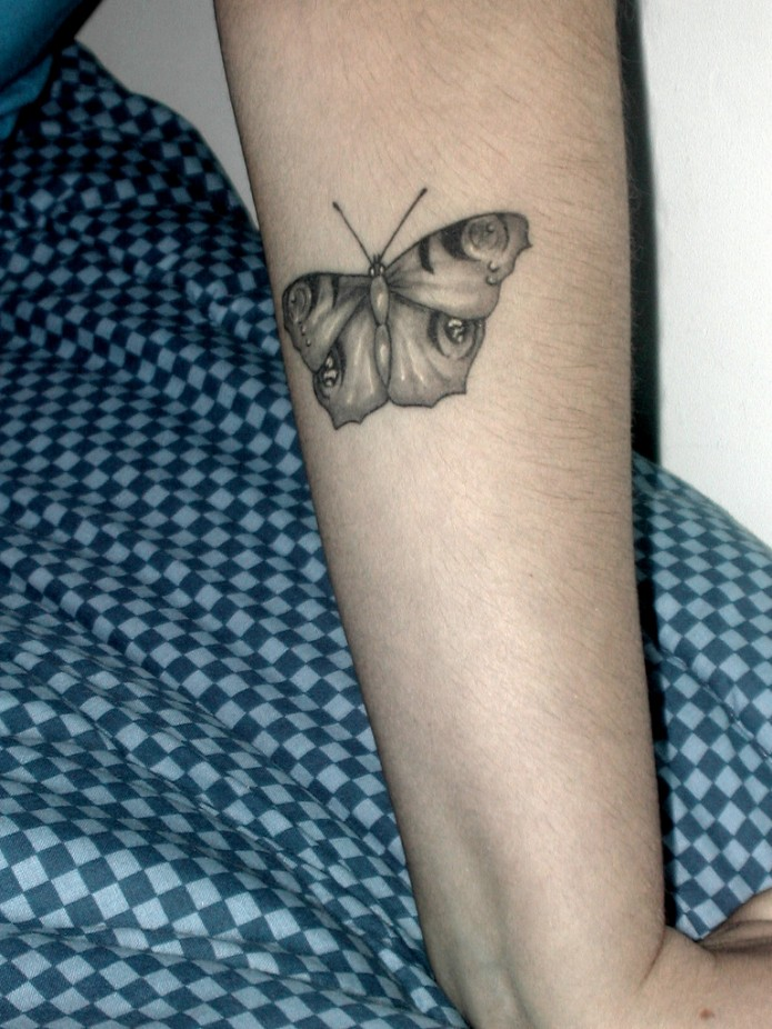 butterfly tattoo on forearm