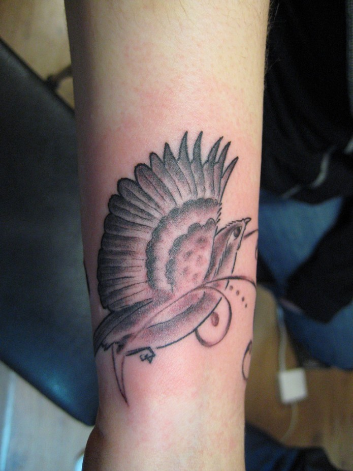 bird tattoo on wrist