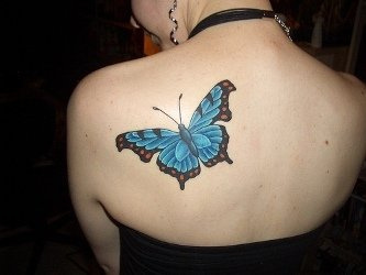 butterfly tattoo on shoulder blade