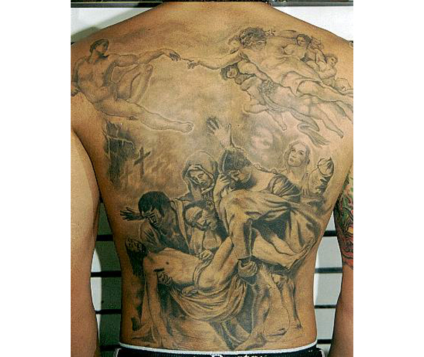 christian tattoo on back