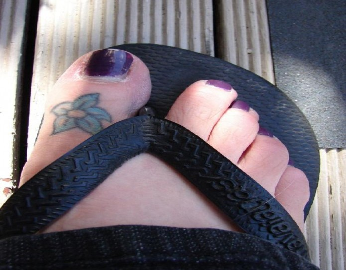 flower tattoo on toe