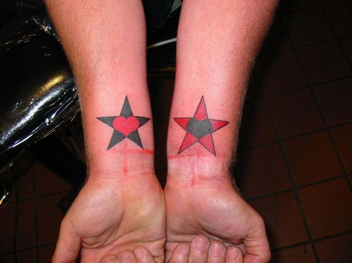 stars tattoo on wrists