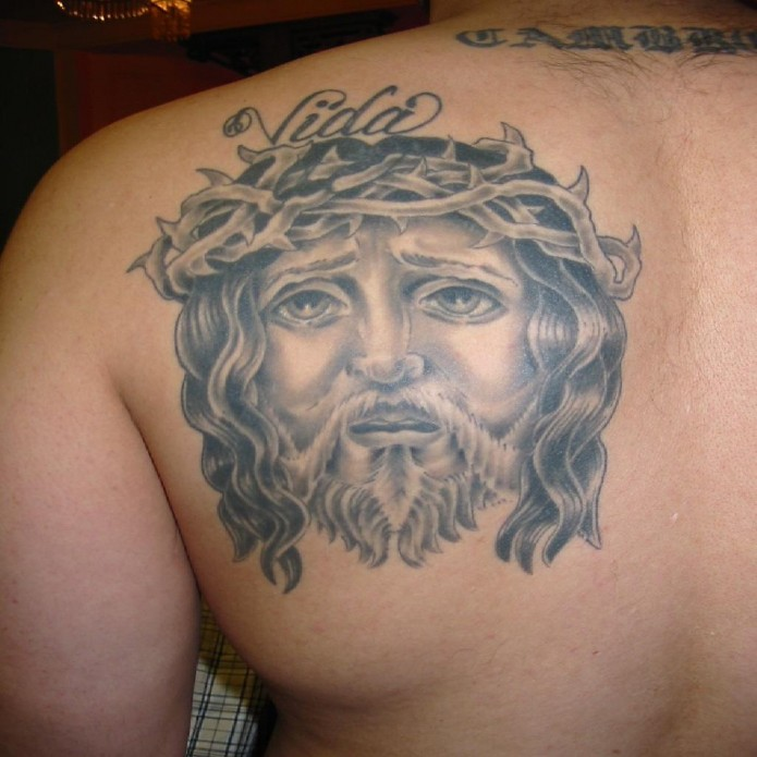 jesus tattoo on shoulder blade