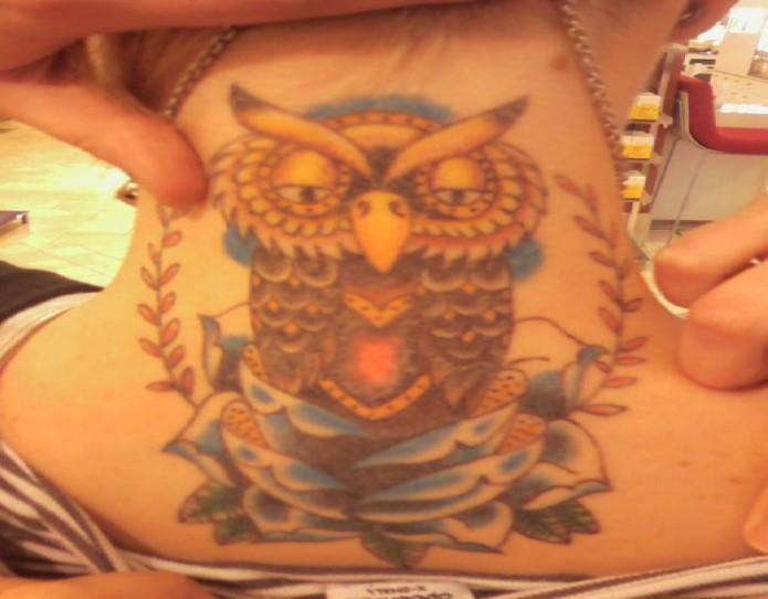 owl tattoo on neck