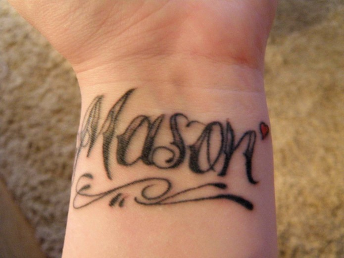 lettering tattoo on wrist