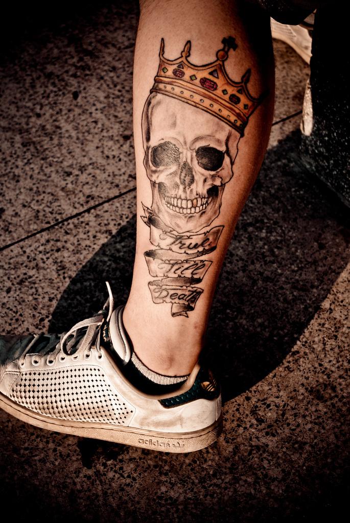 skull tattoo on calf