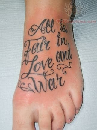 lettering tattoo on foot