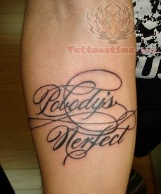 lettering tattoo on forearm