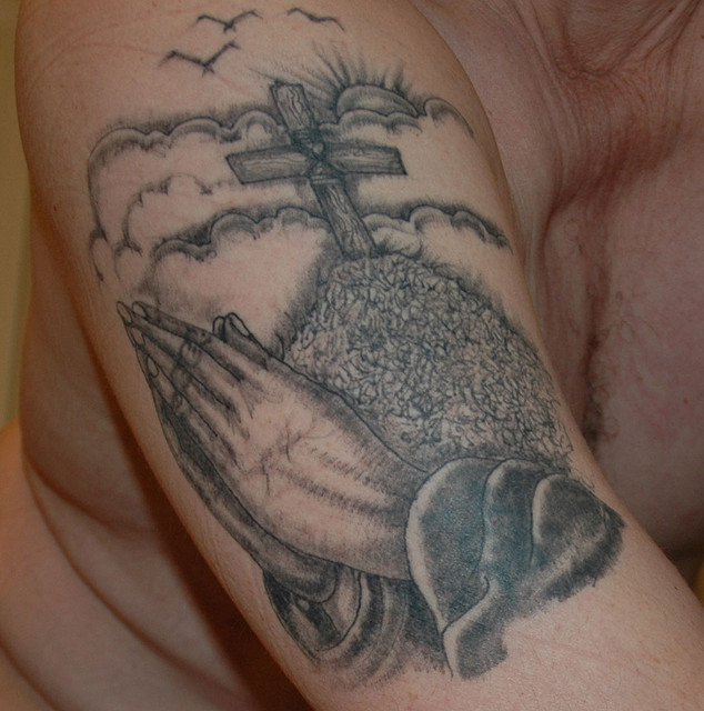 christian tattoo on arm