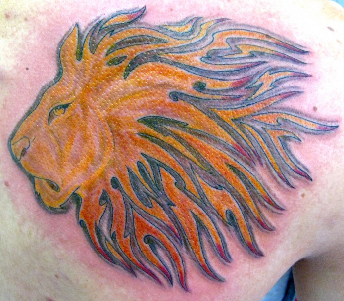 lion tattoo on back