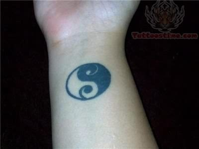 yin yang tattoo on wrist
