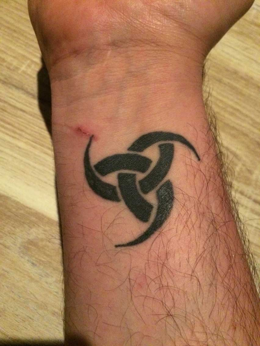 Viking tattoo designs ideas and meanings tattoo me now triple horns of odin is a viking symbol made of three interlocking drinking horns which is a symbol of the nordic god odin triple horns of odin also buycottarizona Choice Image