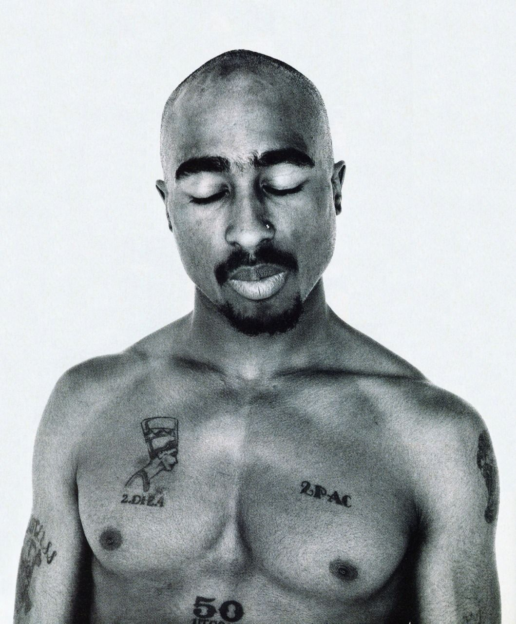 c9cd405559a35 Tupac's Tattoos Are So Famous, But Why? Meanings behind Tupac's Tattoos -  Tattoo Me Now